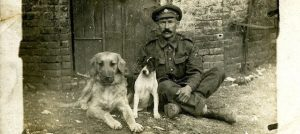 Staff Sergeant (of the Army Service Corps (ASC) with the Corps pet dogs, Hissy and Jack. France, August 1916(All images from the Libby Hall Collection, Bishopsgate Institute Archive)